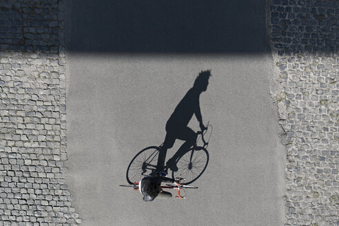 Top view of man riding bicycle - SBOF00714