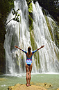 Dominican Republic, Samana, woman admiring huge waterfall - ECPF00111