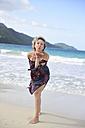Dominican Republic, Samana, woman blowing kisses on the beach - ECPF00120