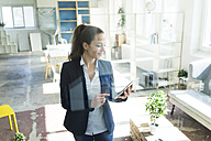 Businesswoman using tablet in a loft - JOSF01748