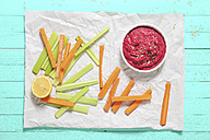 Bowl of beetroot hummus, sesame, and carrot and celery crudites - RTBF01003