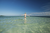 USA, Florida, Key West, Bahia Honda State Park, back view of woman wading into the sea - CHPF00432