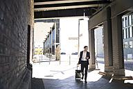 Mature businessman on a trip - FKF02514