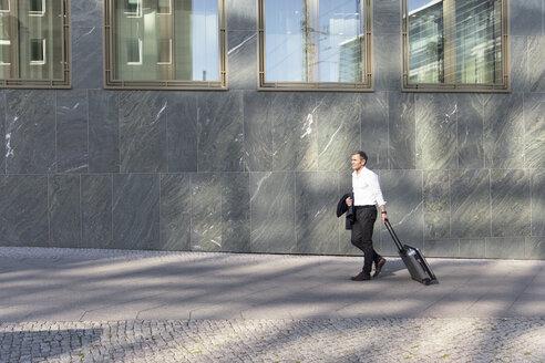 Mature businessman on a trip - FKF02520