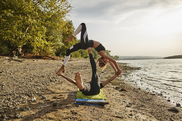 Young man and woman practicing Acro Yoga - ZEDF00889