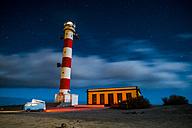 Spain, Tenerife, van parked near lighthouse at night - SIPF01778