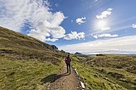 UK, Scotland, Inner Hebrides, Isle of Skye, Trotternish, Quiraing, tourist on hiking trail - FOF09376