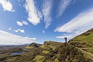 UK, Scotland, Inner Hebrides, Isle of Skye, Trotternish, Quiraing, tourist on hiking trail - FOF09379