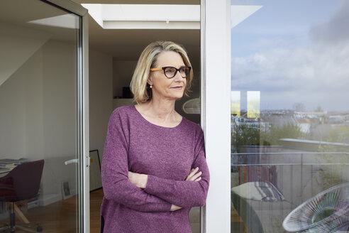 Portrait of confident mature woman on balcony - RBF06032