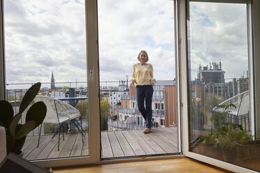 Mature woman at home standing on balcony - RBF06056
