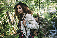 Portrait of teenage girl with backpack and camera in nature - VPIF00101