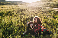 Teenage girl with thermos flask having a rest in nature - VPIF00107