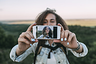 Smiling teenage girl taking selfie in nature - VPIF00137