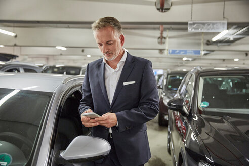 Businessman parking his car at the airport - SUF00331