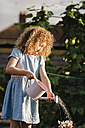 Little girl watering flowers in the garden - NMSF00166
