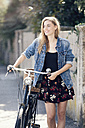 Young woan with bicycle in the city - MAEF12420