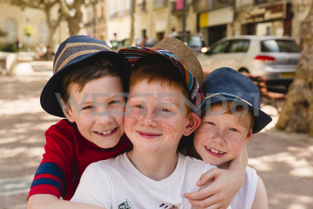 Group picture of three happy boys on holiday - NMSF00175