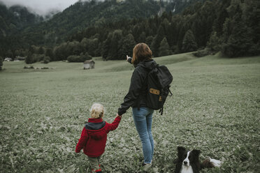 Austria, Vorarlberg, Mellau, mother and toddler with dog on a trip in the mountains - DWF00298