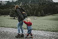 Austria, Vorarlberg, Mellau, mother and toddler on a trip in the mountains - DWF00301