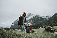 Austria, Vorarlberg, Mellau, mother and toddler on a trip in the mountains - DWF00307
