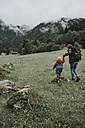 Austria, Vorarlberg, Mellau, mother and toddler on a trip in the mountains - DWF00310