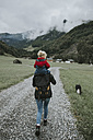 Austria, Vorarlberg, Mellau, mother carrying toddler on shoulders on a trip in the mountains - DWF00316