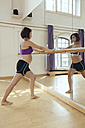 Pregnant woman training in dance studio - MFF03985