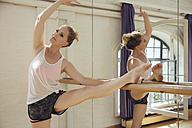 Ballet dancer training in dance studio - MFF03994