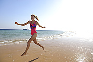 Egypt, Soma Bay, happy woman running on the beach - ECPF00142