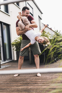 Father and daughter having fun in the garden - UUF11826