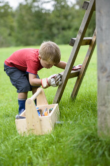 Little boy playing with toy tools - LBF01653