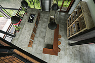 Top view of modern minimalist kitchen in contemporary design house with glass facade surrounded by lush tropical garden - SBOF00808