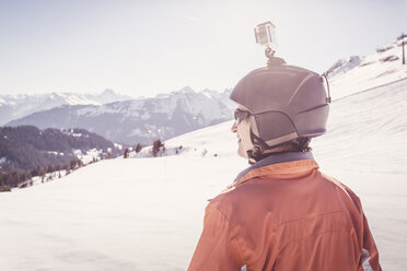 Austria, Damuels, skier with action cam in winter landscape - PNPF00048