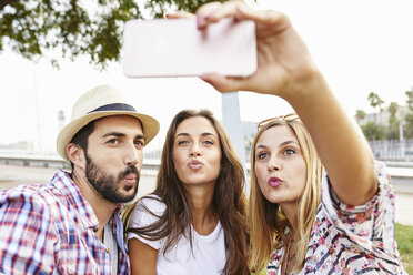 Three friends taking a selfie pouting - JRFF01458