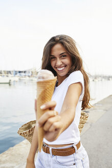 Portrait of smiling young woman holding ice cream cone - JRFF01461