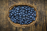Wickerbasker of blueberries on wood - LVF06277