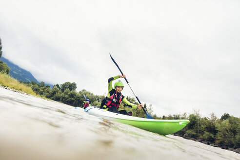 Germany, Bavaria, Allgaeu, couple kayaking on river Iller - PNPF00060