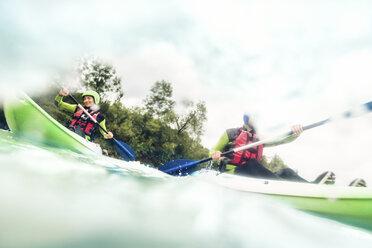 Germany, Bavaria, Allgaeu, couple kayaking on river Iller - PNPF00066