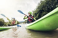 Germany, Bavaria, Allgaeu, couple kayaking on river Iller - PNPF00069