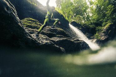 Germany, Bavaria, Allgaeu, young man canyoning in Ostertal - PNPF00075