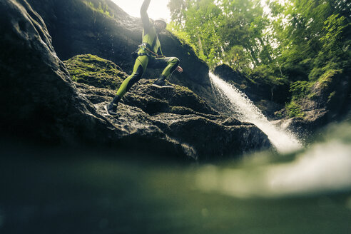 Germany, Bavaria, Allgaeu, young man canyoning in Ostertal - PNPF00075