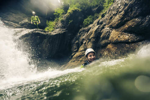 Germany, Bavaria, Allgaeu, young couple canyoning in Ostertal - PNPF00078