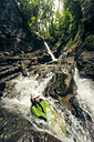 Germany, Bavaria, Allgaeu, man canyoning in Ostertal - PNPF00081