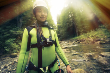Germany, Bavaria, Allgaeu, young woman canyoning in Ostertal - PNPF00084
