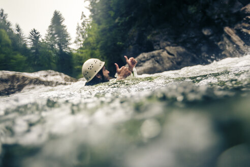 Germany, Bavaria, Allgaeu, man canyoning in Ostertal - PNPF00087