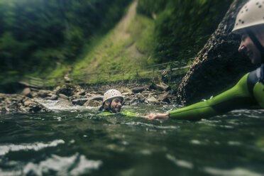 Germany, Bavaria, Allgaeu, young couple canyoning in Ostertal - PNPF00090
