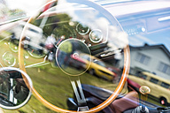 Steering wheel and dashboard of a vintage car - FRF00560