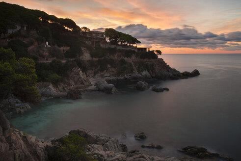 Spain, Catalonia, Lloret de Mar, Cala Trons at twilight - SKCF00321