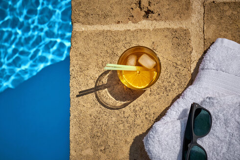 Glass of Crodino, sunglasses and towel at the poolside - DIKF00282