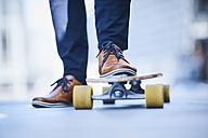 Close-up of man riding longboard - BSZF00024